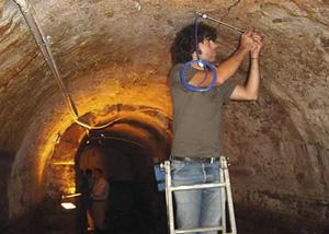 Installation of Geokon vibrating wire crackmeter in Roman Galleries beneath Lisbon, Portugal
