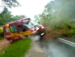 Landslide hits ambulance - from LiveLeak.com