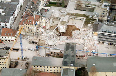 Aerial view of the collapse of Cologne's Historical Archive, thought to be related to an underground subway station and tunnel still under construction.