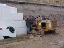 Soil nail rig installing nails adjacent to geofoam blocks. Photo by Bharat Kandel, ADOT via NCS Consultants, LLC.