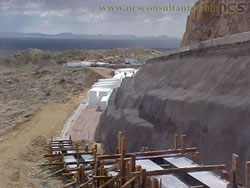 Partially completed hybrid geofoam-soil-nail wall. Note footer for precast facing elements in foreground. Photo courtesy of Bharat Khandel, ADOT via NCS Consultants, LLC.