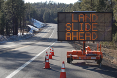 Landslide ahead sign.
