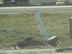 Upheaval of drilled shaft connected to cable barrier. Photo by TxDOT