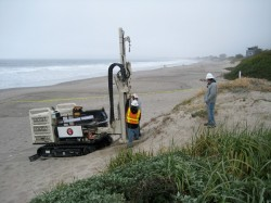 Geophysical contractors use a drill rig to install monitoring wells at Stinson Beach, Calif.