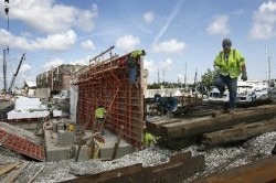 Workers form concrete floodwalls in the New Orleans lakefront area