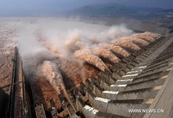 Water sluice down at Three Gorges Dam, central China's Hubei Province, July 28, 2010