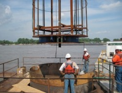 O-Cell frame being lowered into drilled shaft excavation at New Mississipi River Bridge on I-70 project.