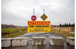 Sign and barricades at the road closed by the St. Jude Landslide in Quebec