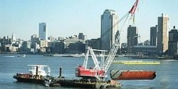 Blast shield being lowered into Hudson River