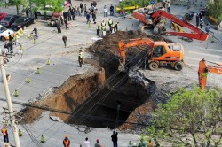 Sinkhole in a Beijing Street on April 26, 2011 - possibly resulting from tunneling ground loss from Beijing subway construction