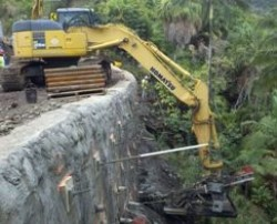 Excavator mounted TEI Rock Drill to install tieback anchors in Hawaii