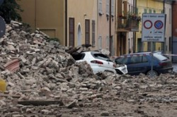 Cars were crushed by the ruins of the destroyed Clock Tower in Finale Emilia, Italy after a magnitude-6.0 earthquake shook the region early Sunday.