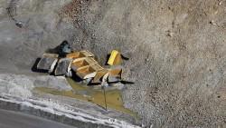 Haul trucks damaged by the landslide toe at Bingham Canyon Mine, UT April 2013.