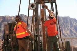 Crux Subsurface employees drilling geotechnical holes for the US 89 landslide investigation
