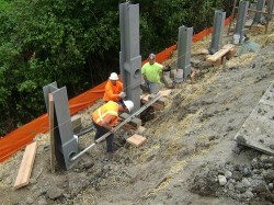 Installing a soldier pile lagging wall near I-5 and Samish Way on-ramp in Washington State