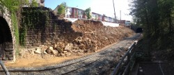 View of failed Baltimore retaining wall before soldier pile wall construction