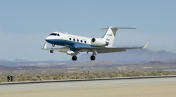 NASA's C-20A Earth science research aircraft with the UAVSAR slung underneath its belly lifts off the runway at Edwards Air Force Base on a prior radar survey mission.