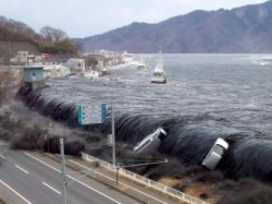 A tsunami flowing into the city of Mikayo after the 9.0 magnitude Fukushima earthquake March 11, 2011 (JIJI PRESS/AFP/GETTY IMAGES)