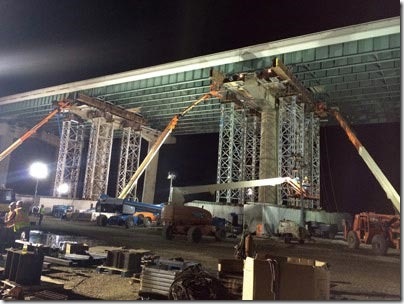 Shown here is the jacking and leveling operation, taking place at night.