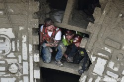 Seattle Tunnel Partner workers roosting in the spokes of the Bertha TBM after the breakthrough