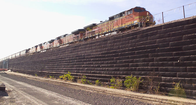 Geosynthetic Reinforced Soil Slope Supporting a Rail Line, Strata Geosynthetics