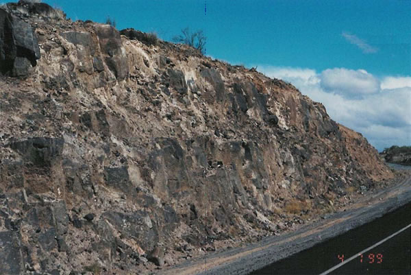 Figure 4 This slope in basalt was blasted using techniques that reduced rock mass disturbance but left behind some drill traces. However the drill traces are not apparent from the driver's perspective.