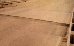 Bump at the end of a bridge approach slab.
