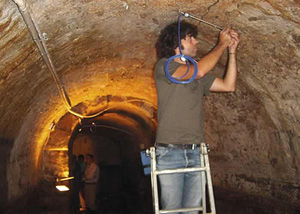 Installation of Geokon vibrating wire crackmeter in Roman Galleries beneath Lisbon, Portugal