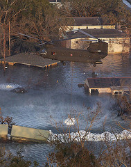 Katrina levee failure with Chinook Helicopter attmpting to fill the breach