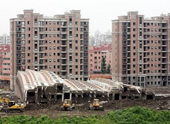 A building at the Lotus Riverside complex in Shanghai's Minhang district collapsed
