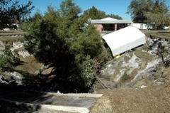 60-ft plus deep sinkhole in Frostproof takes a carport, threatens a house