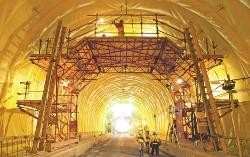 Lining work being performed on the Devil's Slide Tunnel