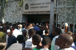 Haitians wait outside the Canadian embassy in the days after the earthquake, hoping to emigrate