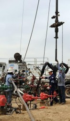 Crew from Andarko Petroleum Corp. works on fracking a well
