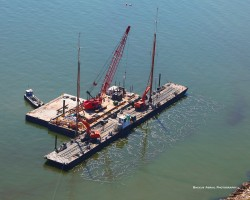 Installing wick drains via barge at Craney Island Port in Norfolk, Virginia