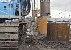 Malcolm drilling crews setting up to drill secant pile shafts for TBM launch pit