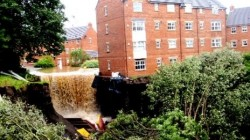 Floods undermine the foundations of a building in Newcastle, UK