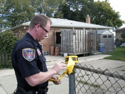 Police in Roseville, MI tape off a driveway thought to cover the remains of Jimmy Hoffa