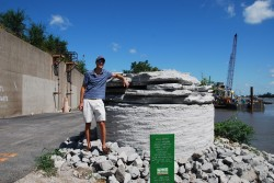 A geotechnical 'monument' - An 11-foot diameter limestone rock core excavated for the I-70 crossing of the Mississippi River.  David Graham of Dan Brown and Associates is pictured visiting the monument.