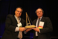 DFI President Jim Morrison presents the DFI Distinguished Service Award to David B. Coleman