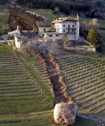 A giant boulder smashes through a barn of an Italian farmhouse