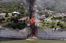 Teetering Cliff House Deliberately Set On Fire