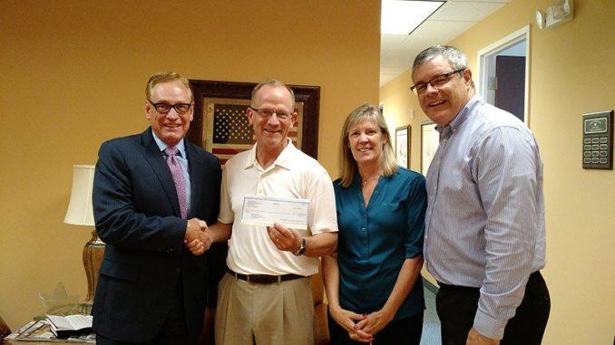 Terracon foundation awarding a scholarship