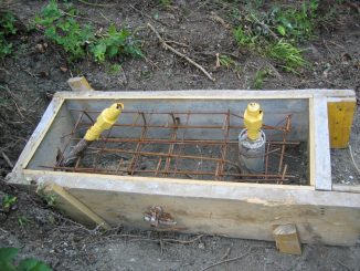 Example of simple post base support used for high energy rockfall catchment fences consisting of a small concrete pad, two soil anchors and a micropile tube. Source: AGHP