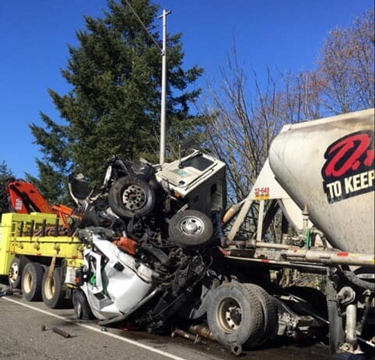Crushed pickup truck as semi-truck strikes geotechnical drilling site