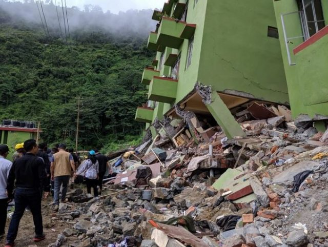 Damage to apartment buildings after landslide in Mizoram, India